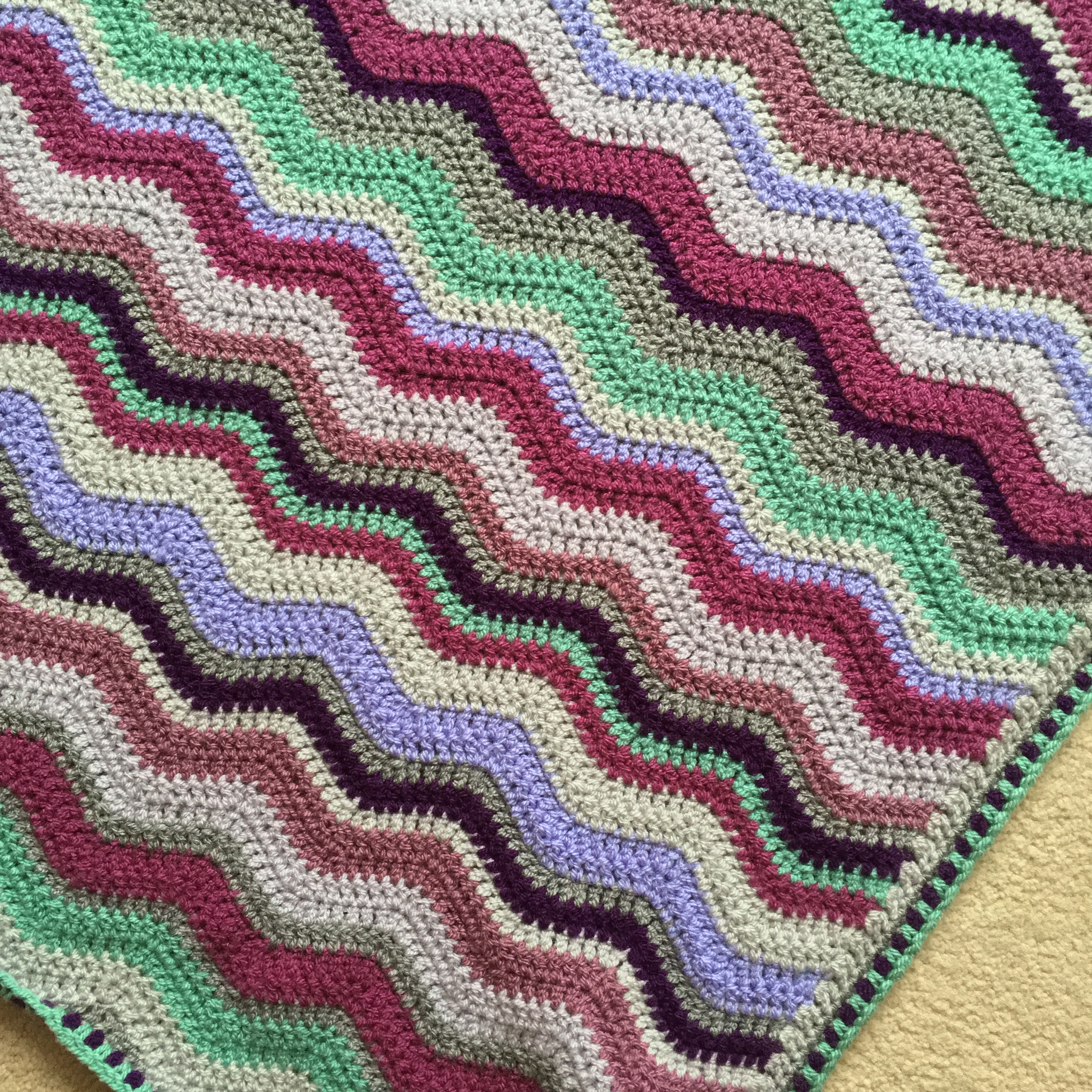 The blackberry ripple blanket finished the little room of rachell see my zesty raspberry ripple blanket post for info about the double crochet spike stitch edging bankloansurffo Images
